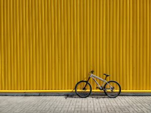 Bike leaning against yellow wall